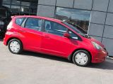 Photo of Red 2009 Honda Fit
