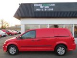 Photo of Red 2013 RAM Cargo Van