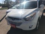 Photo of White 2011 Hyundai Tucson