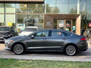 Used 2017 Ford Fusion SE w/ AWD / LEATHER / NAVIGATION for sale in Calgary, AB