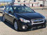 Photo of Black 2014 Subaru Impreza