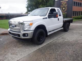 Used 2015 Ford F-350 SD XLT SuperCab 4WD 8 Foot Flatdeck for sale in Burnaby, BC