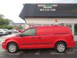 Photo of Red 2013 RAM Cargo Van