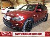 Photo of Red 2009 BMW X5