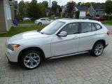 Photo of White 2012 BMW X1