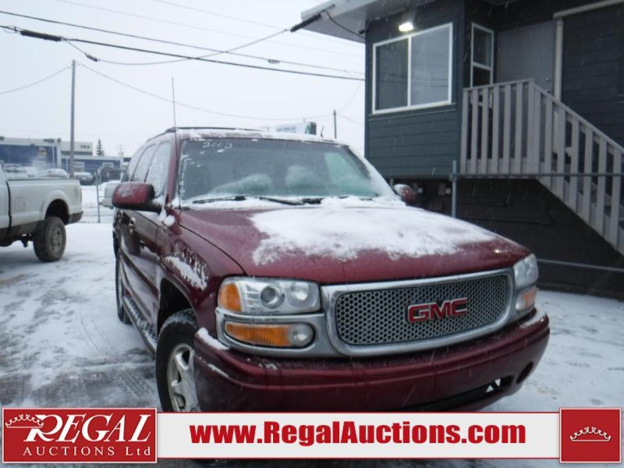 Photo of Red 2002 GMC Yukon Denali