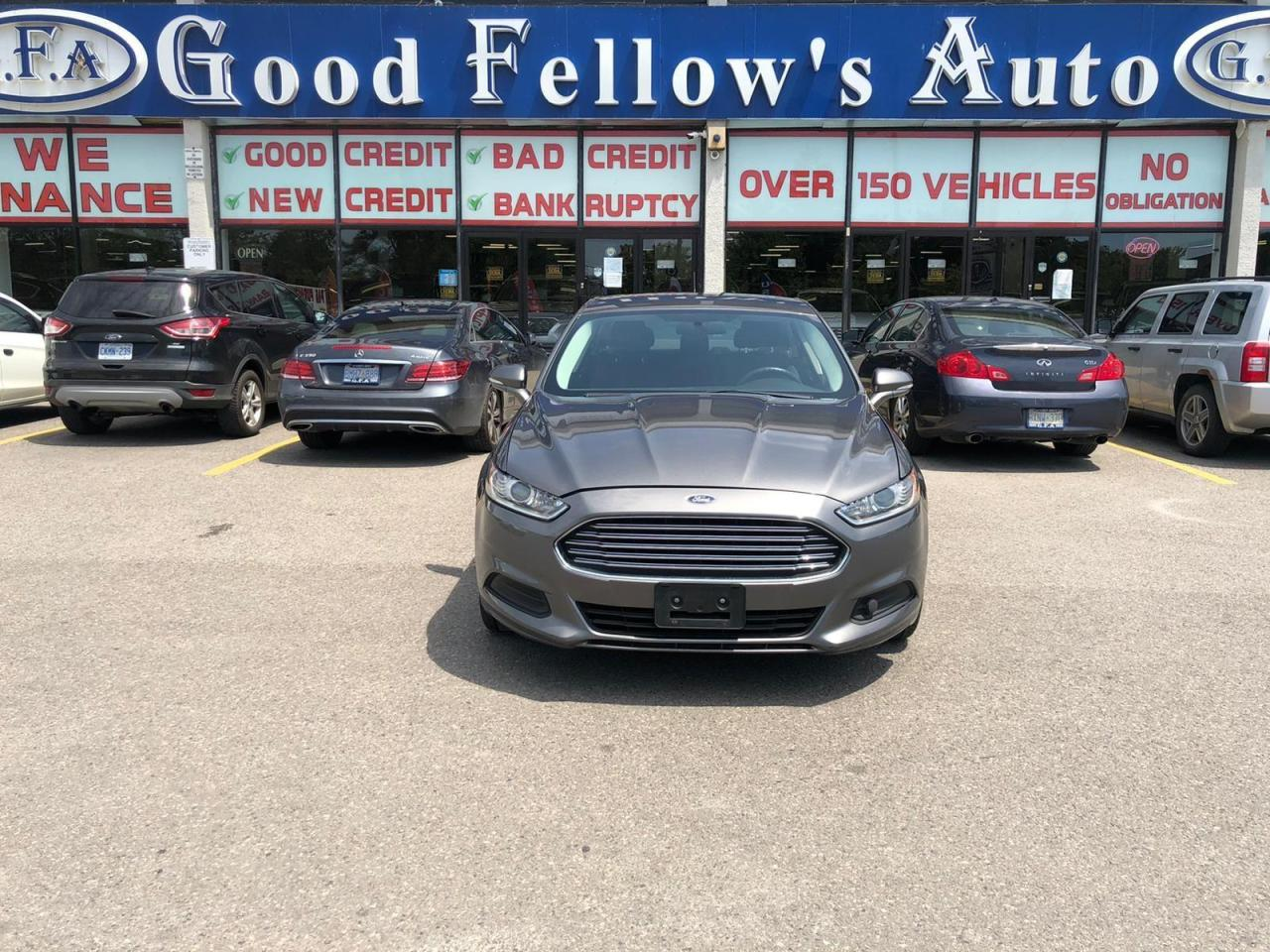 used 2014 Ford Fusion car, priced at $8,999